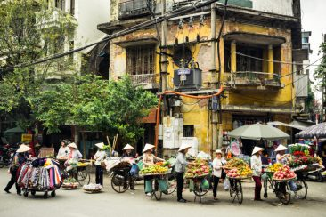 Hanoi street vendors gather outside the train station